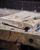 A piece of liomewood being prepared for a sculpture by Fabian Ewert